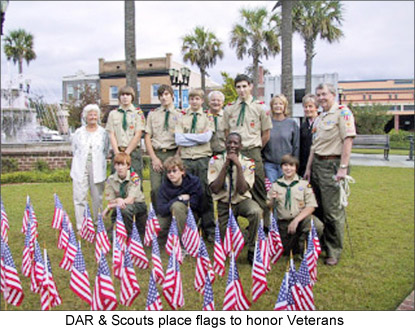 Image of DAR members and Scouts who placed flags to honor Veterans