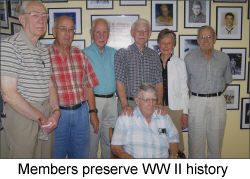 Image of a members working to preserve WWII history