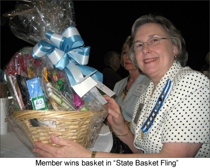 Image of a DAR member winning a basket in the 'State Basket Fling'